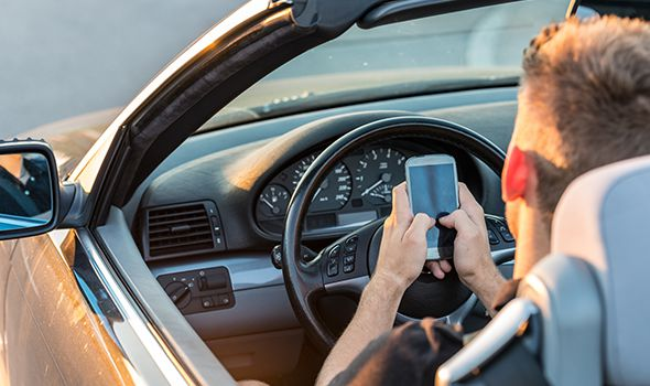 looking at phone while driving image on distracted driving accidents page for Heintz & Becker, a law firm in Sarasota and Bradenton florida