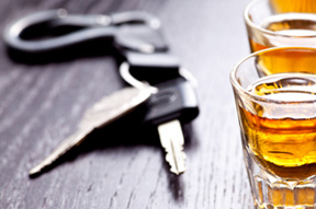car keys next to whiskey on Heintz & Becker's DUI injury page
