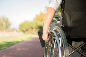 poicture of a person using a wheelchair for the spinal cord injury page for a florida law firm
