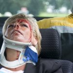woman with a neck brace to support her spinal cord after a severe car accident